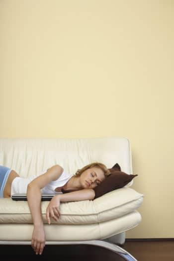 woman sleeping on a sofa